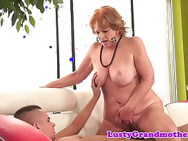 Chubby granny sucking a huge black monster cock riding it