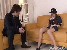 Cute horny Yuzu Shiina in her airline outfit fingers her tight pussy on camera