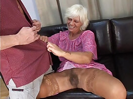 Mature granny in absolute sex with young man on sofa