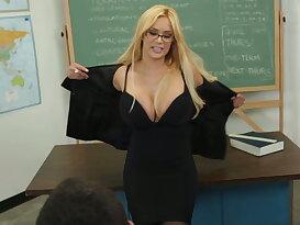 Professor Shyla speaks with Daniel after class